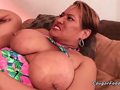This horny and busty brunette slut with amazing big tits